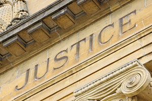 justice-written-on-building